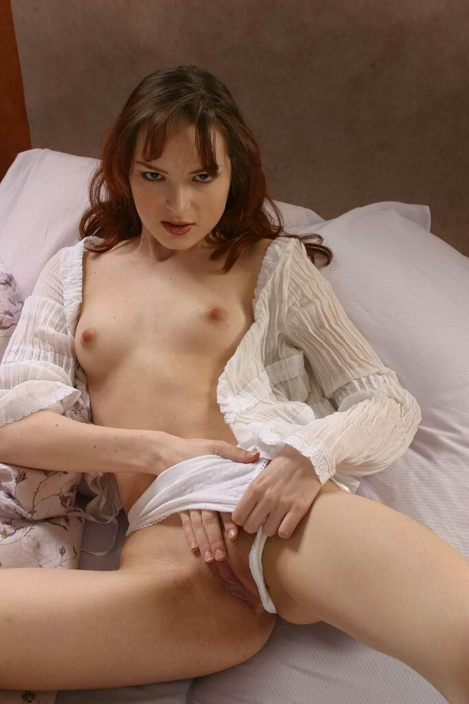 Sweet girl removes white panties to show meaty pussy