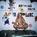Sweet russian blonde posing on playground