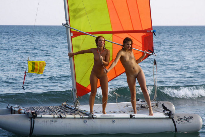 Two bare girls on various sea transports
