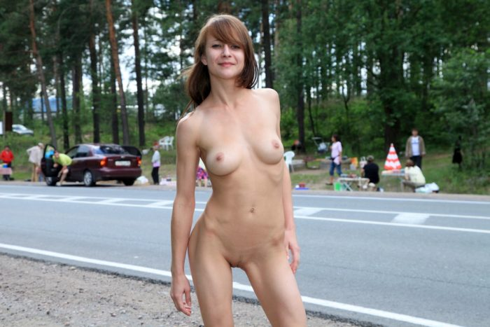 Young girl Elizaveta T with slender body on the road