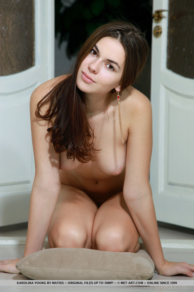 Youthful Karolina Young shows off her gorgeous nubile body with beautiful breasts and smooth shaven pussy in front of the camera.