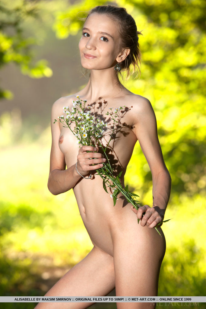 Alisabelle playfully poses outdoors as she bares her petite body.
