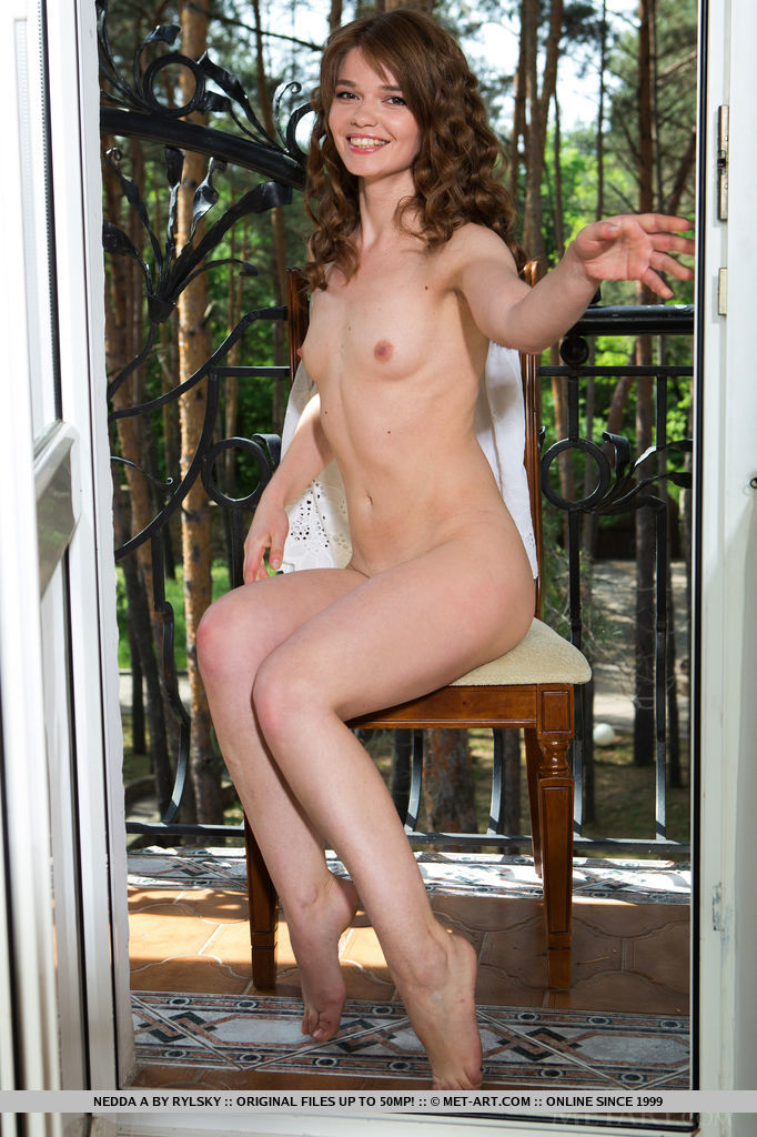 An outdoor loving person, Nedda loves spending afternoons reading a book by the veranda, soaking in the warm sunlight, or feeling the cool wind in her naked body and showing off her flexible limbs.