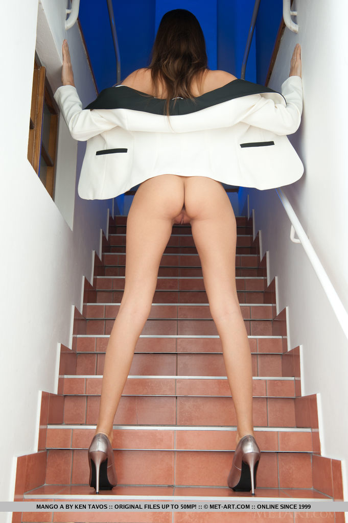 Aside from a gorgeous beach babe, Mango also looks great in a white blazer and silver stiletto shoes that compliment her long and slender legs.