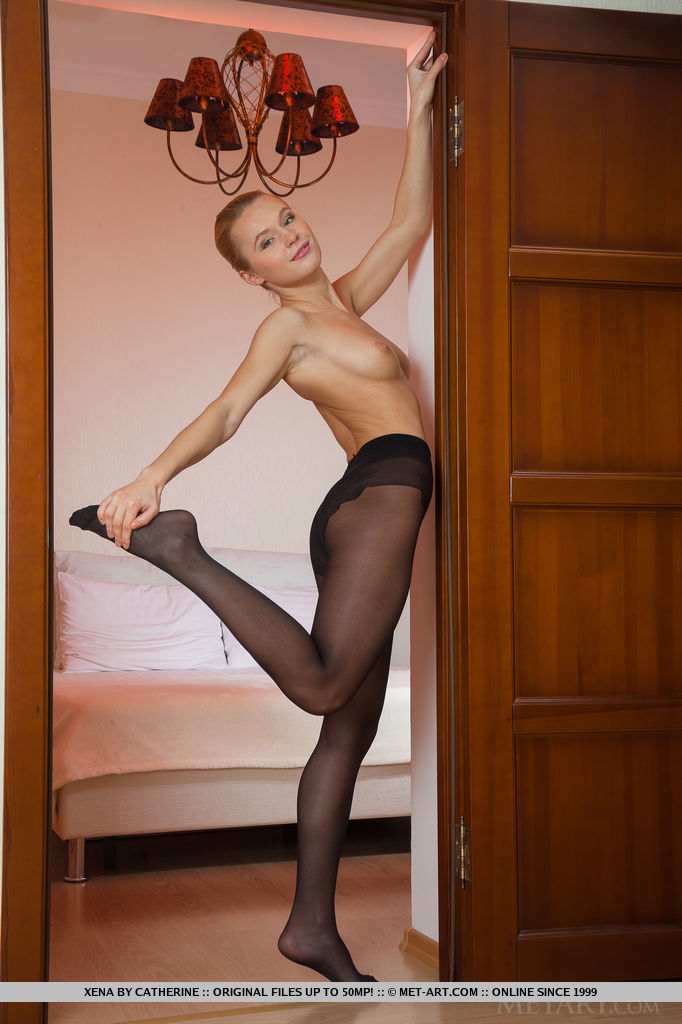 Beautiful Xena, strips her black lingerie panty with matching thigh-high stocking as she   flaunts her gorgeous body by the bedroom door.