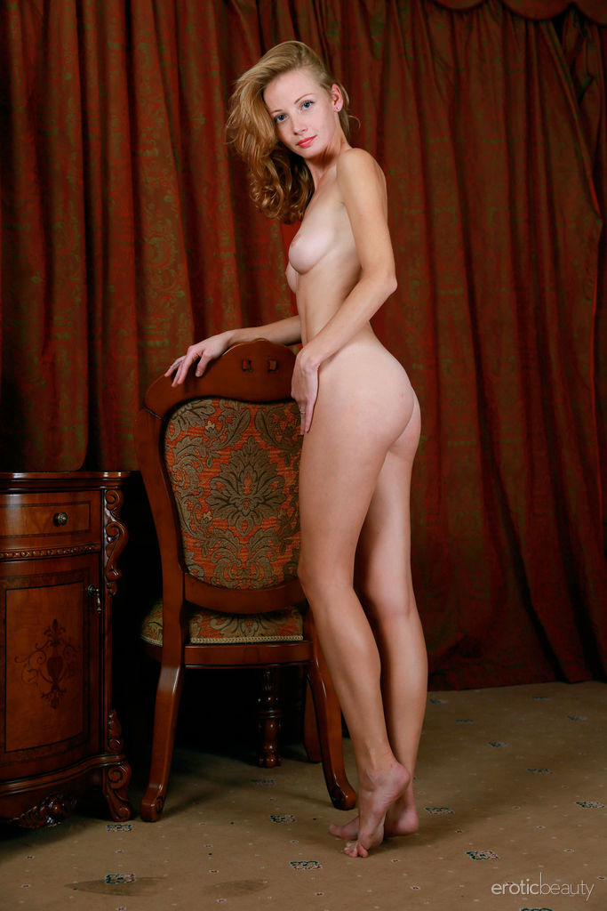 Diana Bronce shows off her slender, sexy body and sweet pussy on the chair.