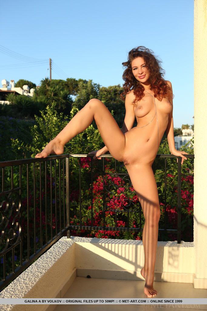 Galina A flaunts her gorgeous, tanned body on the balcony.