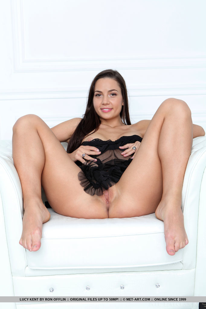 Lucy Kent strips her sexy night dress and bares her sexy body as she poses on the white   chair.