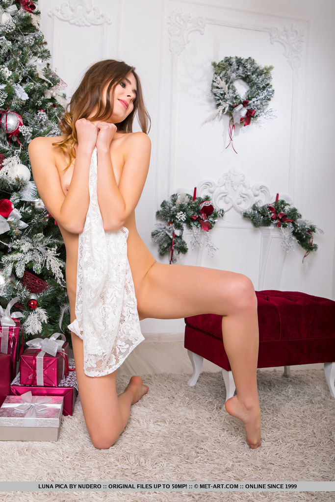 Luna Pica shows off her perky tits and slender body as she poses by the Christmas tree.