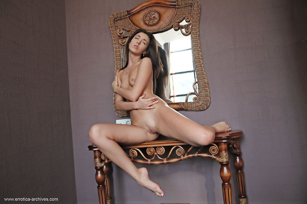 Malvina flaunts her hot, slender body with small puffy breasts and sexy legs in front of the   camera.