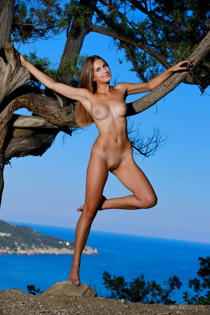 Newcomer Milenia strips outdoors baring her sexy, slender body and sweet pussy.