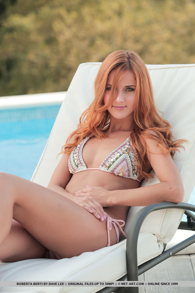 Roberta Berti lounges by the poolside wearing a sexy bikini that shows off her spectacular physique.