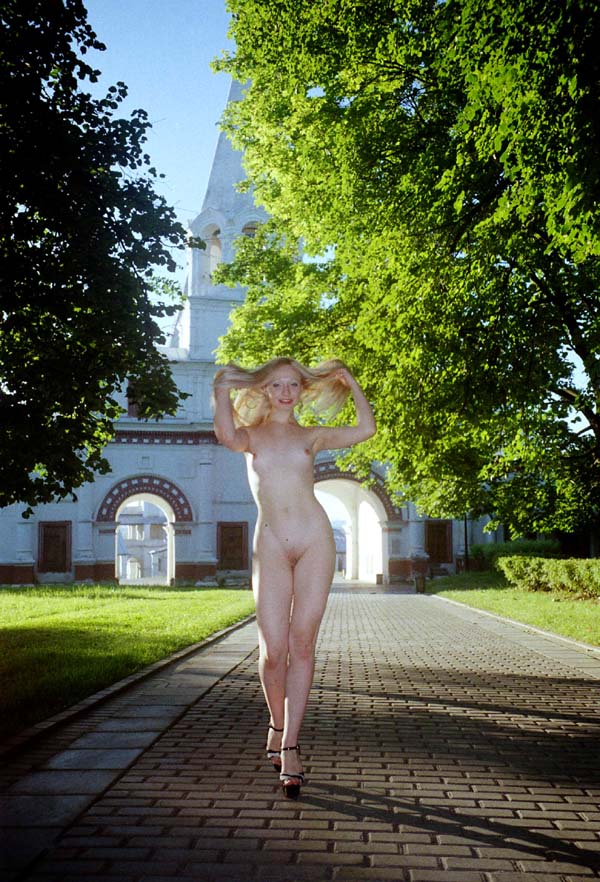 Russian blonde Elza with slender body walks at park
