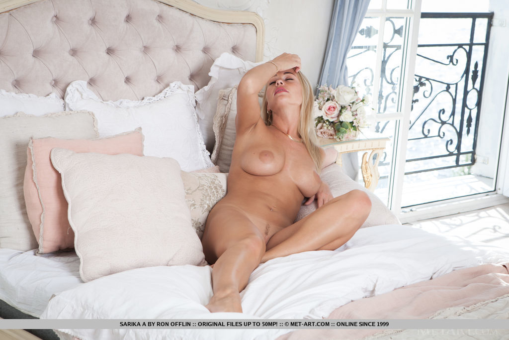 Sarika A flaunts her gorgeous tits and curvy body on the bed.