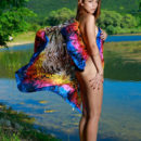 Alicia Love sensually poses by the river as she bares her slender body.