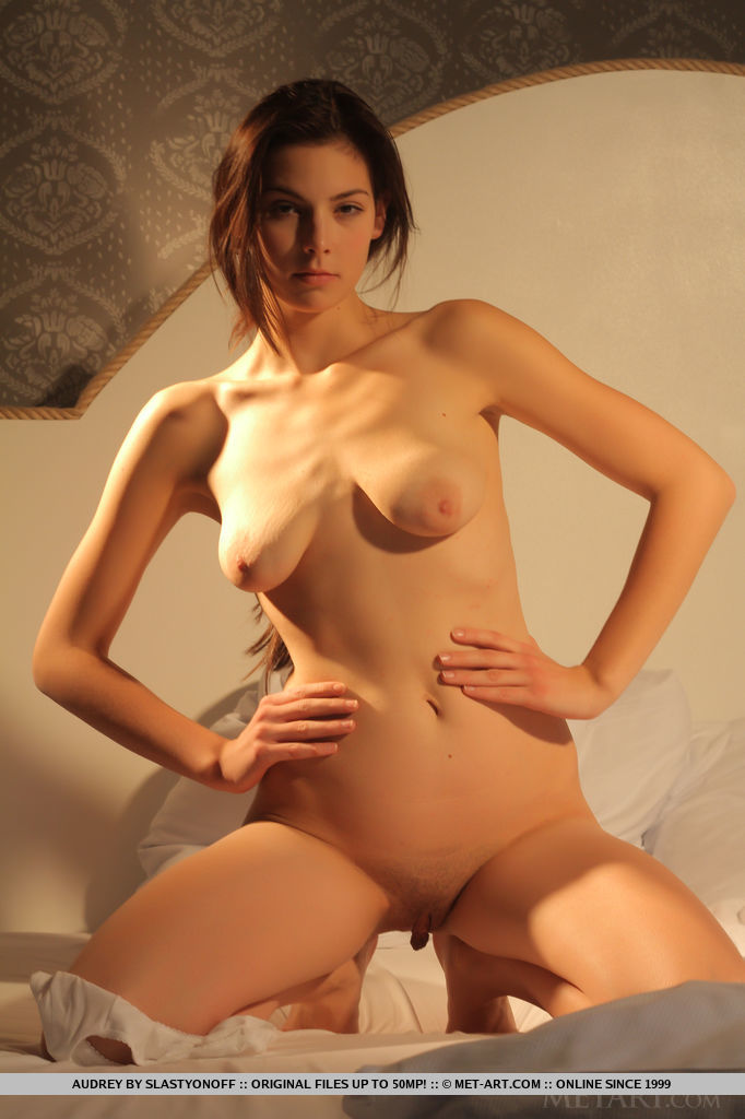 Audrey displays her sexy, lusty body along with her natural, and amateur beauty with innocent   appeal on the bed.