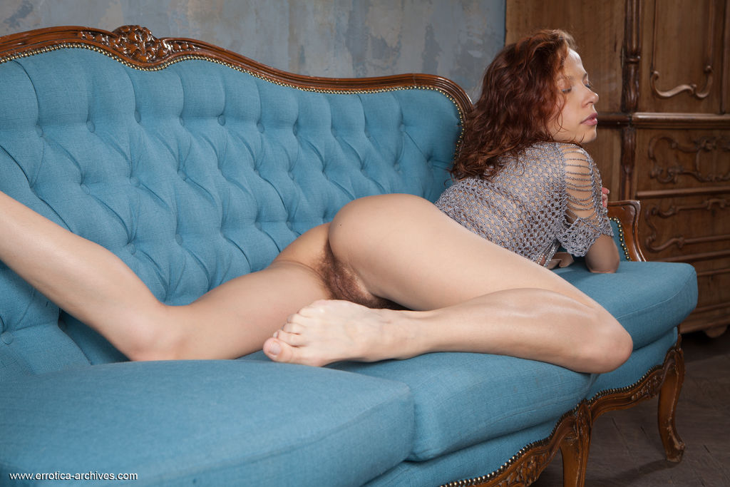 Dennie spreads her legs wide open as she bares her unshaven pussy.