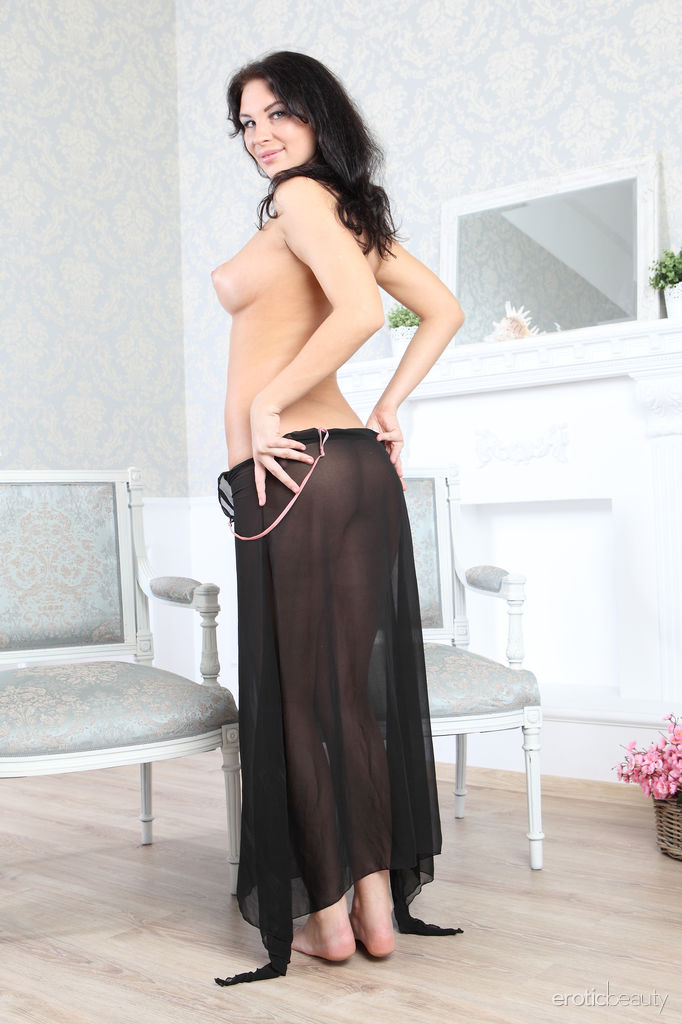 Galina A undressed her sexy night gown and displays her sexy, curvy body along with her large,   puiff breasts in front of the camera.