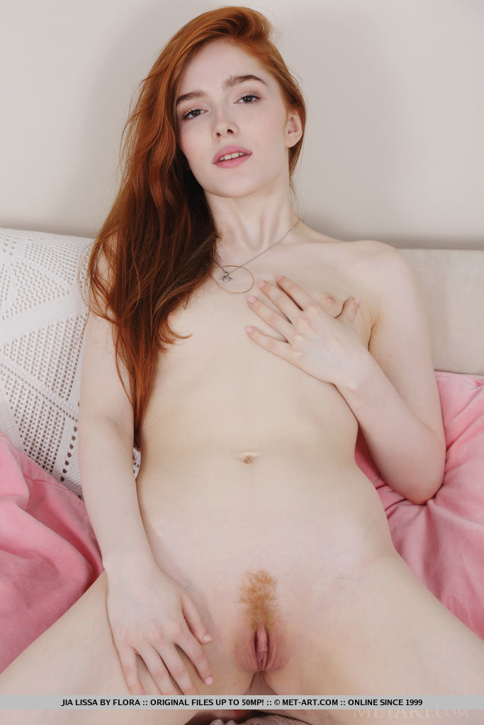 Jia Lissa bares her petite body and trimmed pussy on the couch.