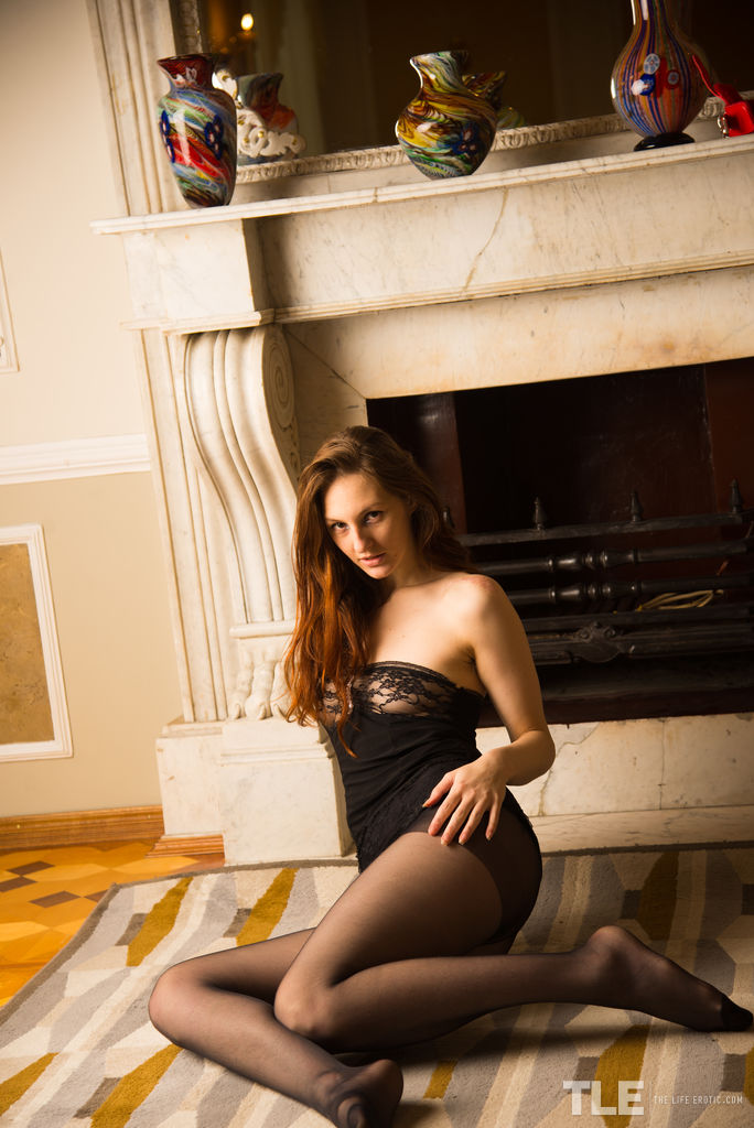 Newcomer Ariadna plays with her delectable pussy on the floor.