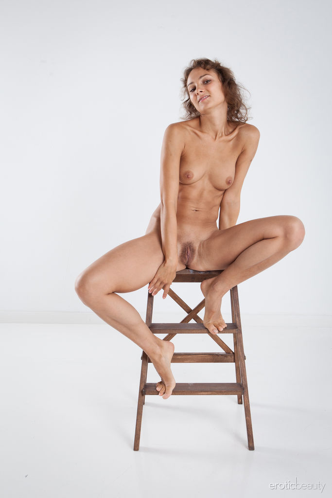Sanna shows off her tight, athletic body and trimmed pussy on the chair.
