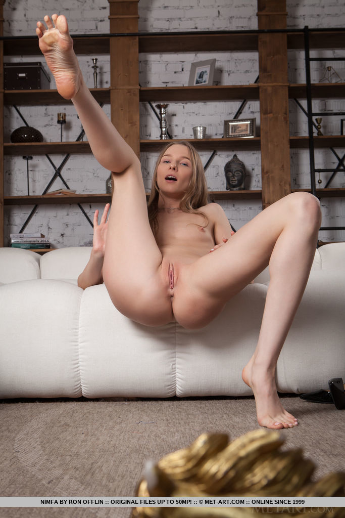 Top model Nimfa flaunts her sexy, tight body as she strips on the sofa.