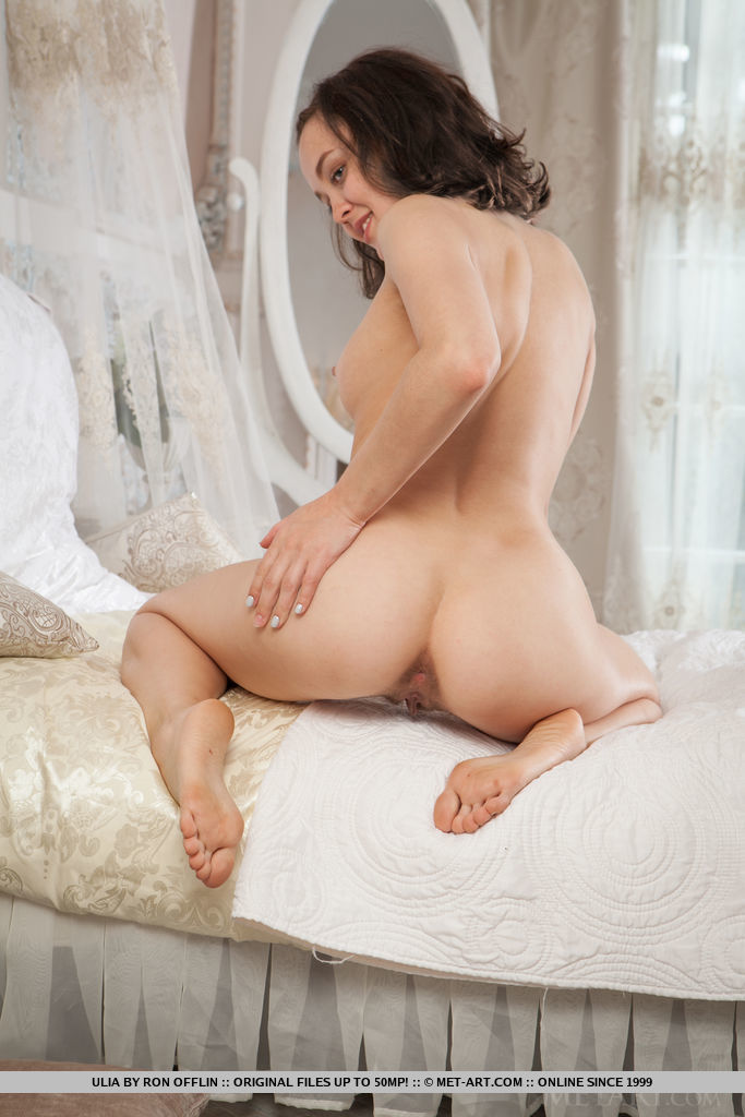 Ulia bares her nubile body and unshaven pussy on the chair.