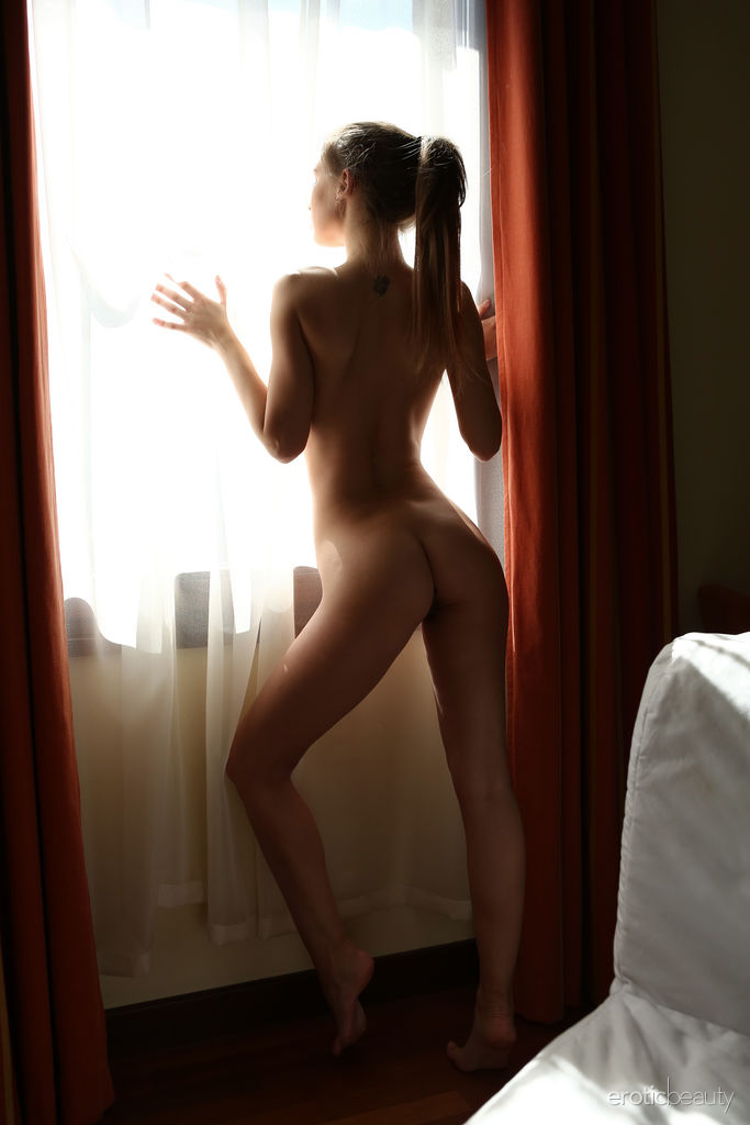 Galina A strips on the bed as she bares her delectable body.