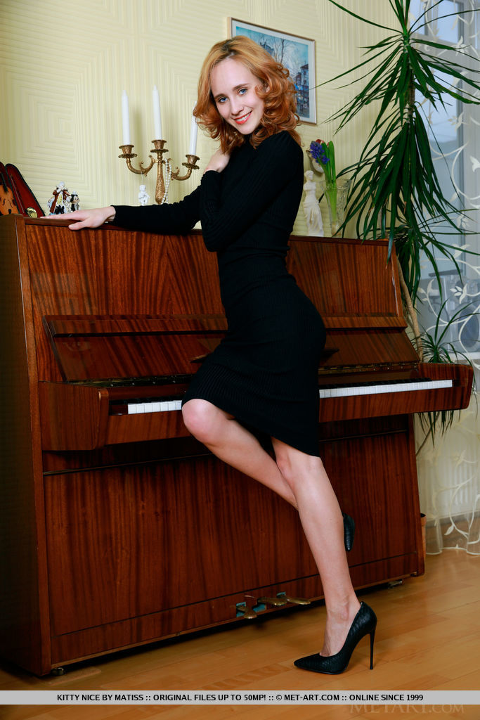 Kitty Nice bares her beautiful, creamy body as she strips by the piano.