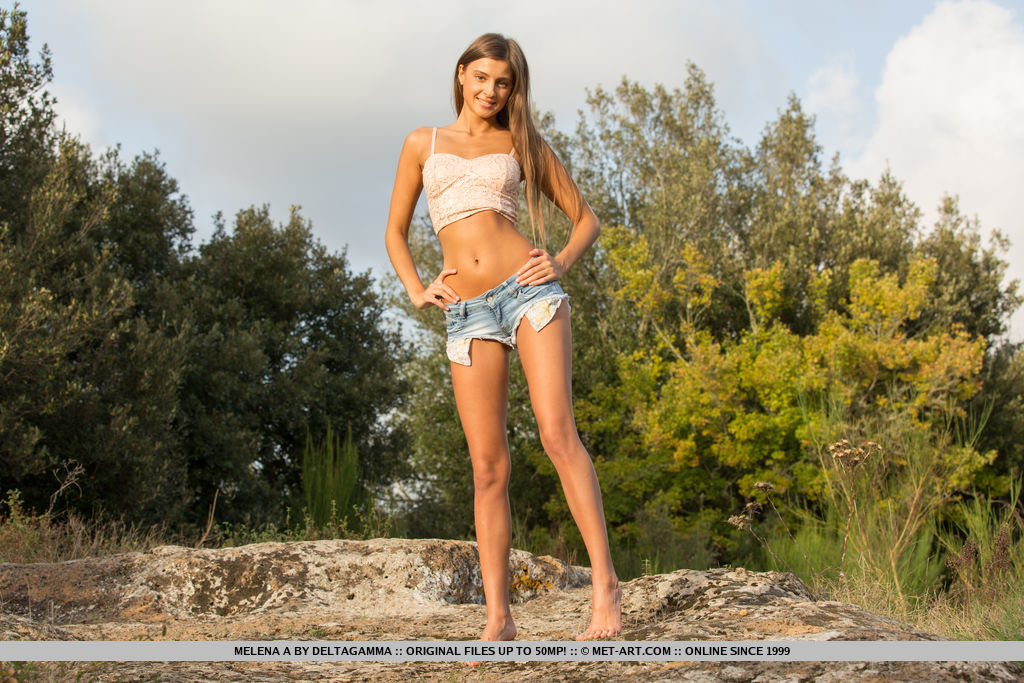 Melena A shows off her smoking hot body as she strips outdoors.