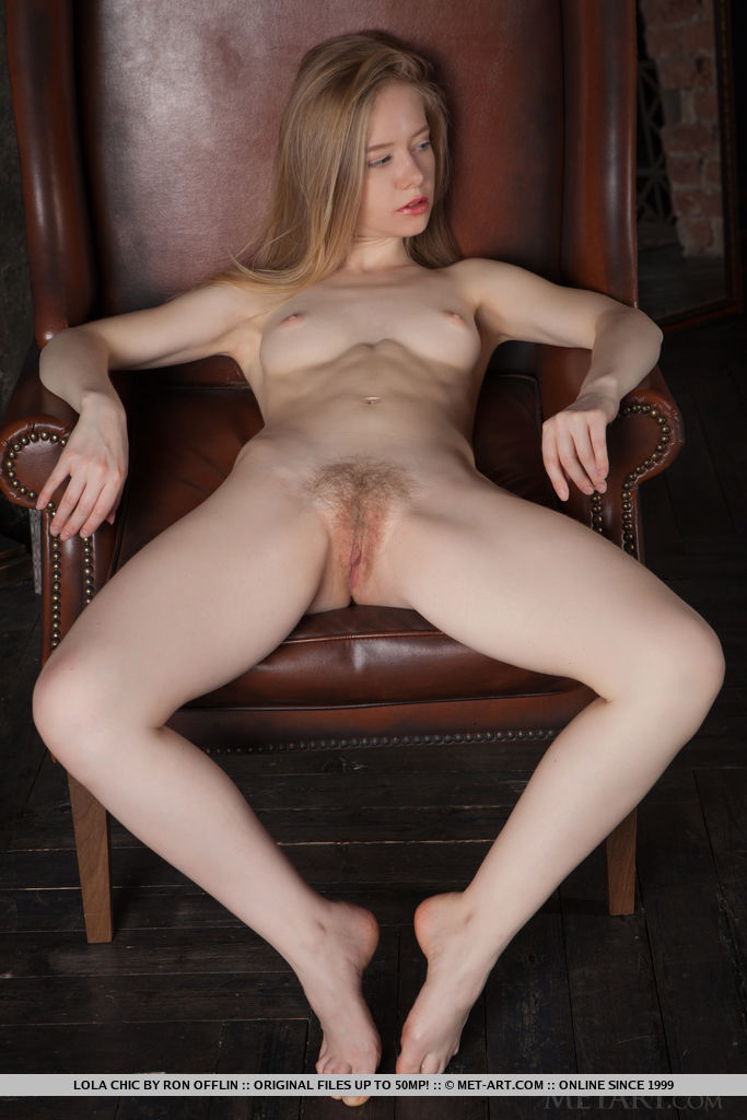 Newcomer Lola Chic bares her creamy body and hairy pussy on the chair.