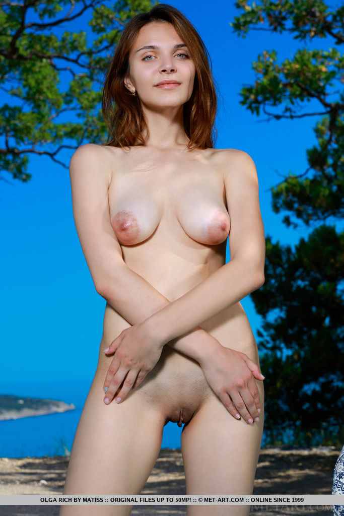 Olga Rich strips by the beach as she displays her creamy body with puffy tits.