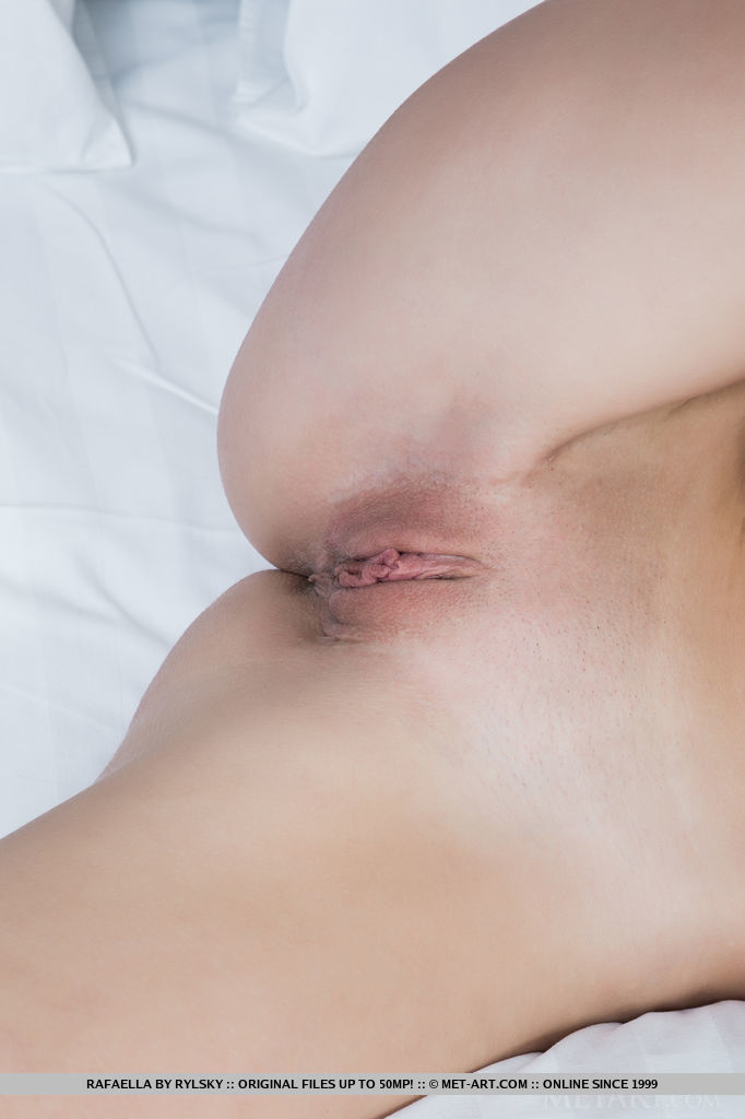 Rafaella bares her lean and slender body and delectable pussy on the bed.