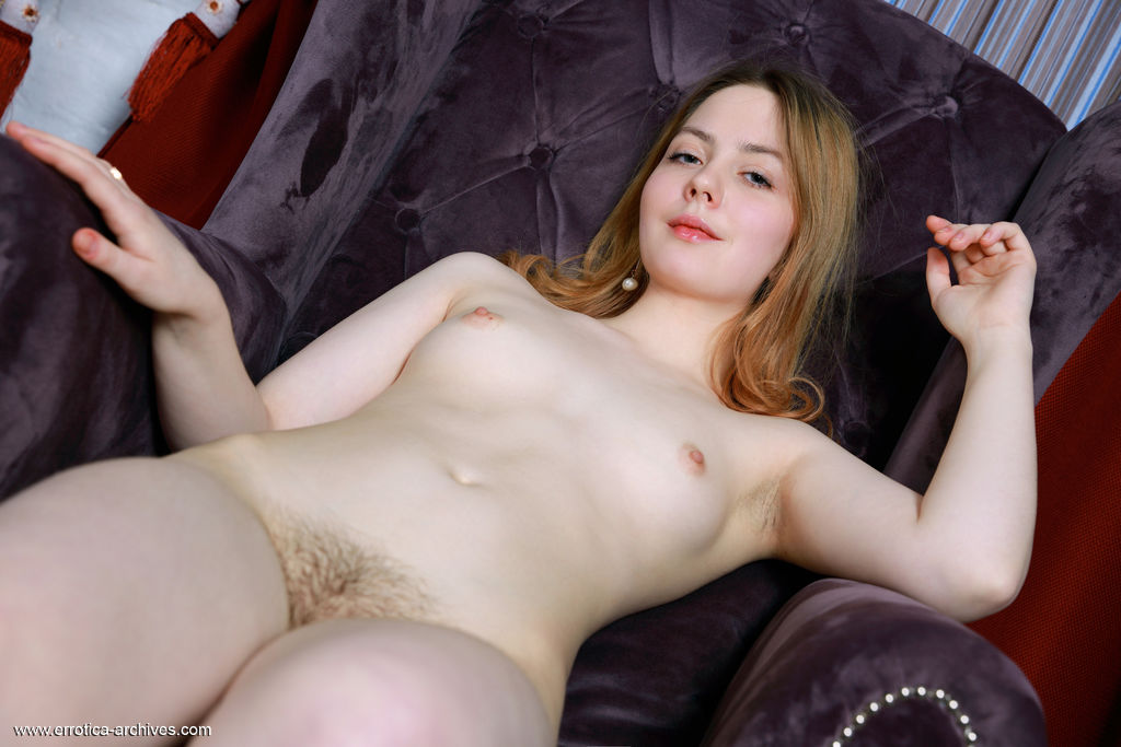 Rita displays her creamy body with pink nipples and trimmed pussy on the chair.