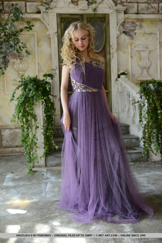 Taking off her flowy purple dress, a vision of the naked goddess Angelika D with smooth porcelain skin and heavenly assets can be captivating to any mere mortal.