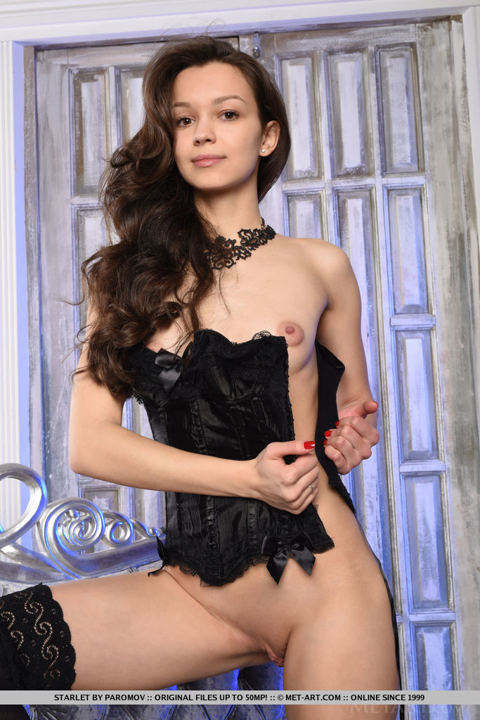 The ever stunning Starlet garbed in black bustier  with lace choker cuffs, matching lace panty, and thigh-high stockings that amplifies her elegant beauty.