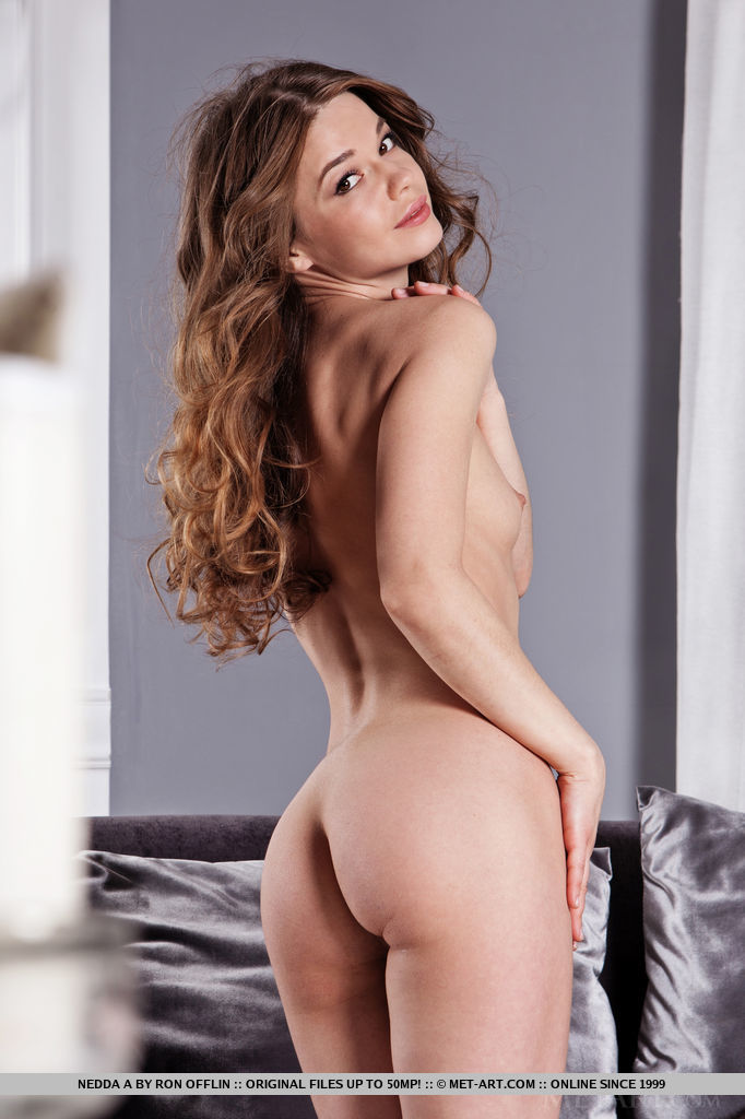 A luxurious soft fur hugging Nedda A's delightfully nubile body and fresh assets, complimenting her youthful beauty.
