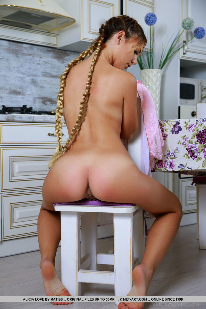 Alicia Love strips in the kitchen as she bares her yummy body.