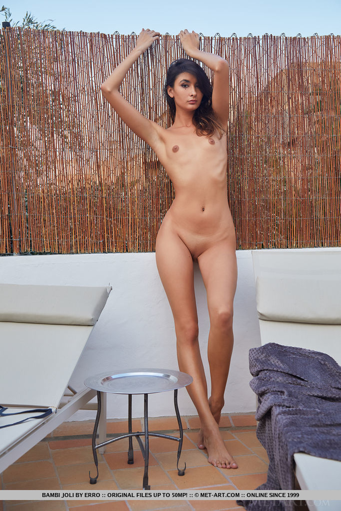 Bambi Joli proudly showing off her tanned body with wide open poses