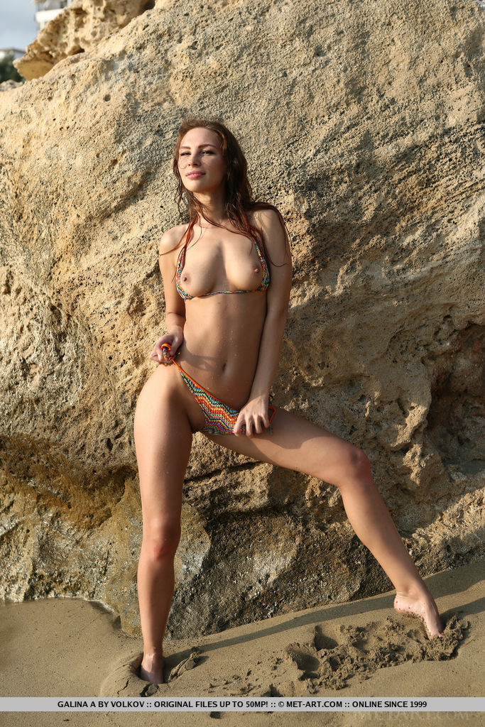 Galina A poses at the beach baring her sexy, wet body.