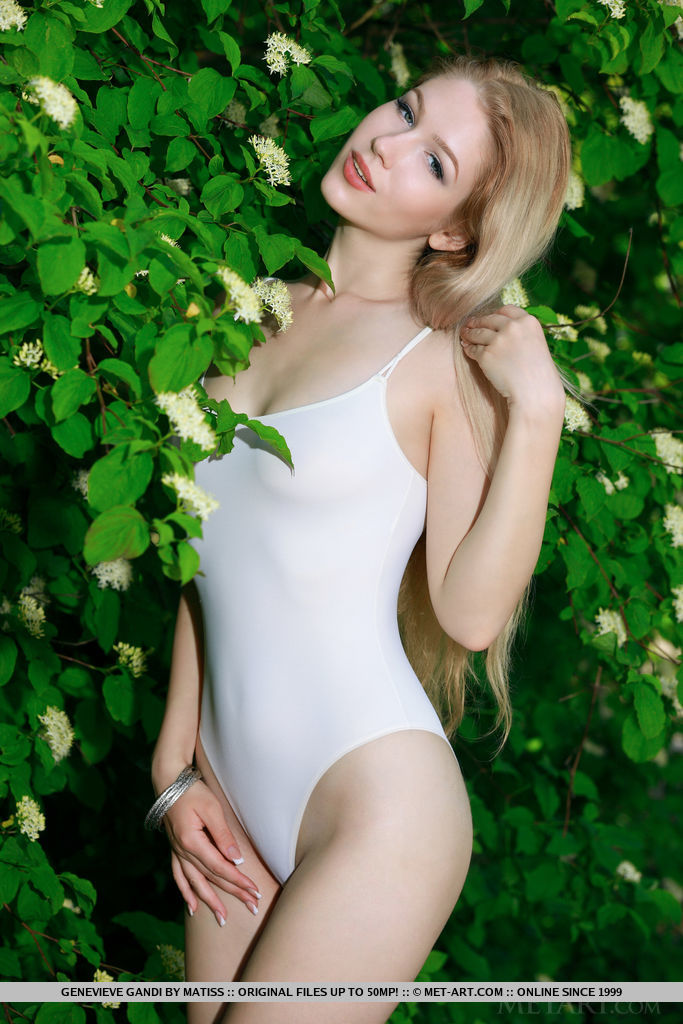Gorgeous blonde Genevieve Gandi shows off her amazing body outdoors.