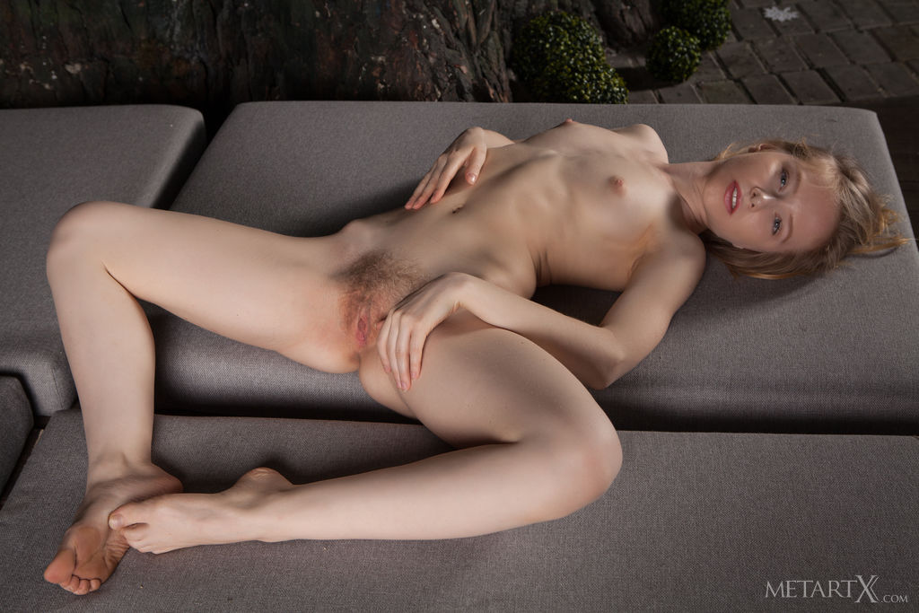 Lola Chic savors the cool evening air on her skin as she sprawls naked in the outdoors