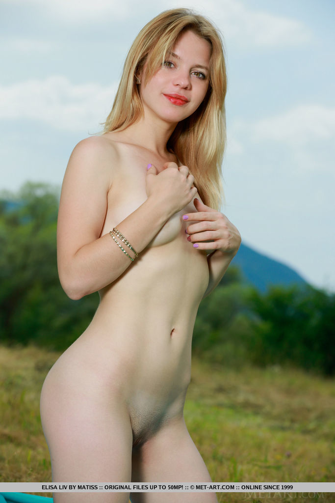 Newcomer Elisa Liv strips outdoors as she bares her nubile body.