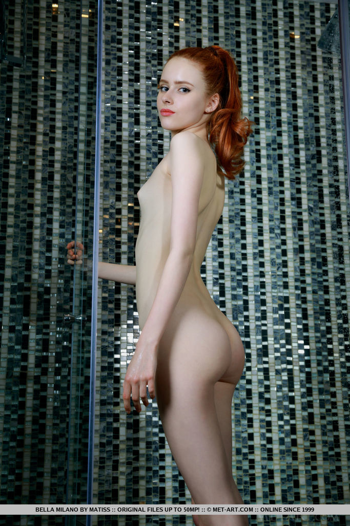 Redhead Bella Milano flaunts her petite, creamy body as she poses in the shower.