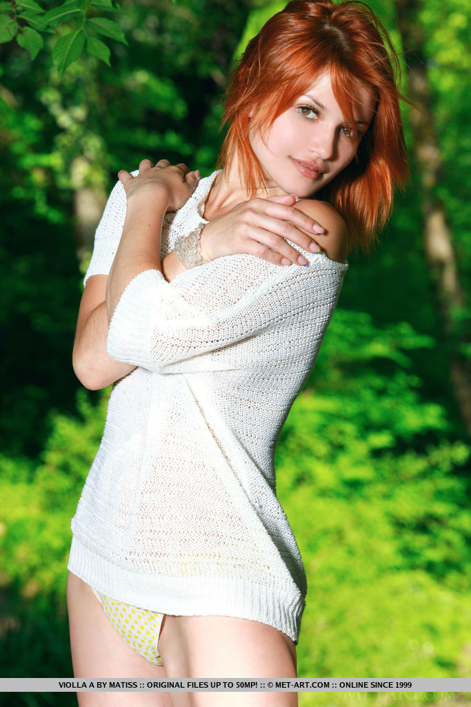 Redhead Violla A strips by the river baring her sexy body and sweet pussy.