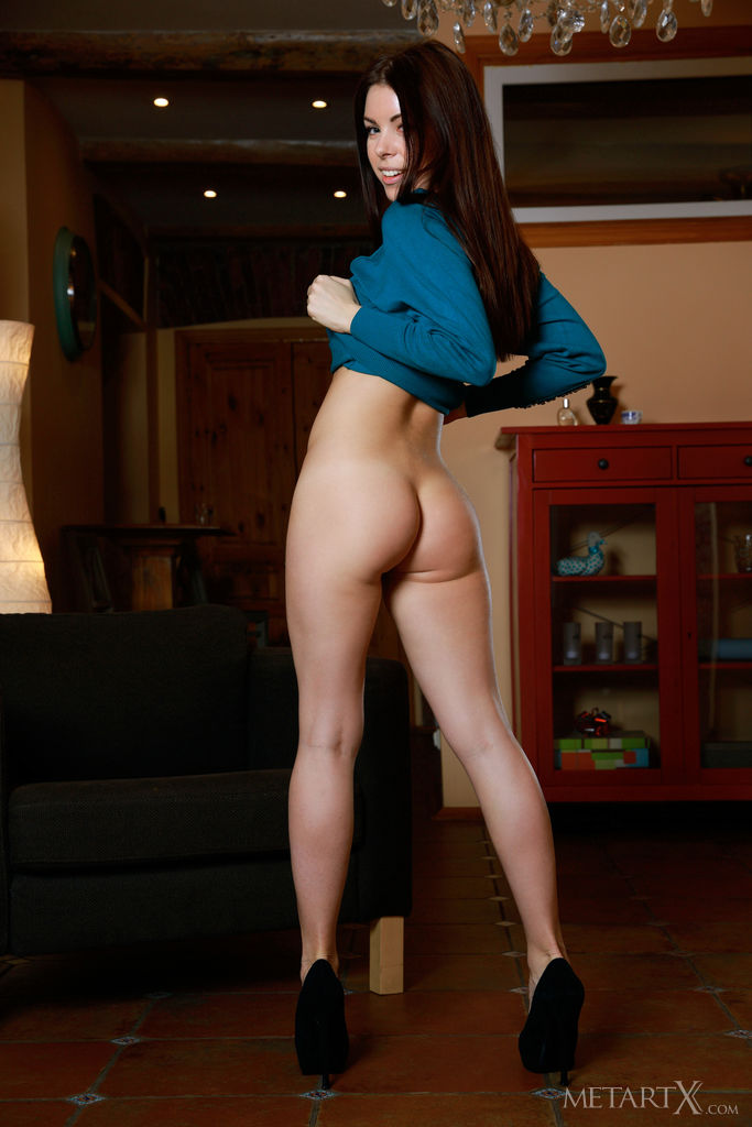 Vivian looks fresh and vibrant, playfully displays her athletic body and poses erotically outdoors.