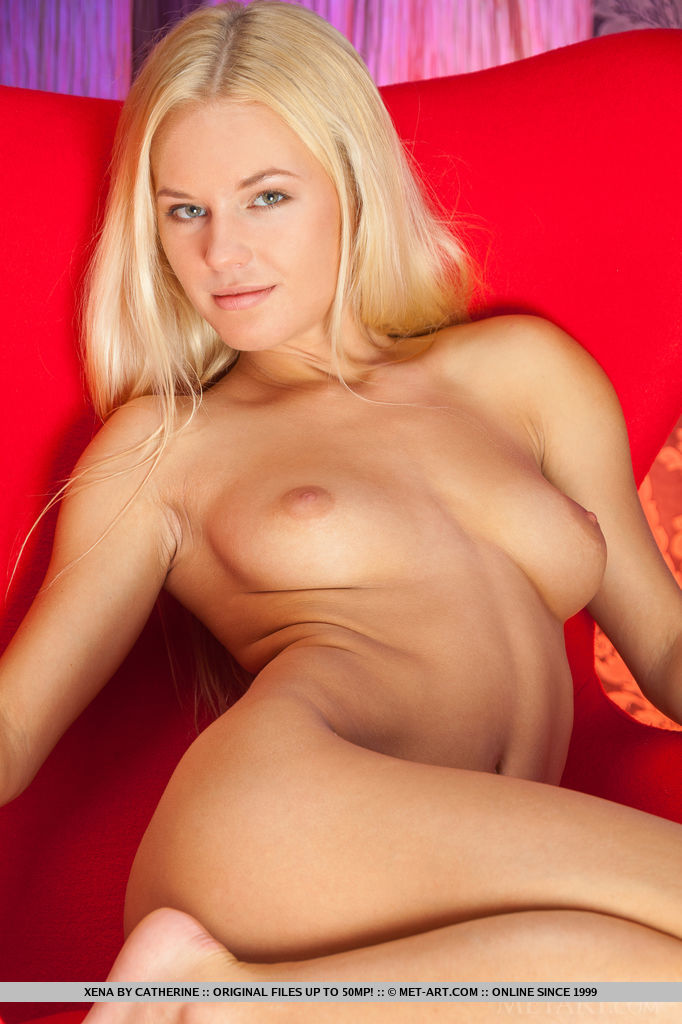 Sprawled seductively on the couch, Xena strips and showcases her sexy physique and delectable pussy.