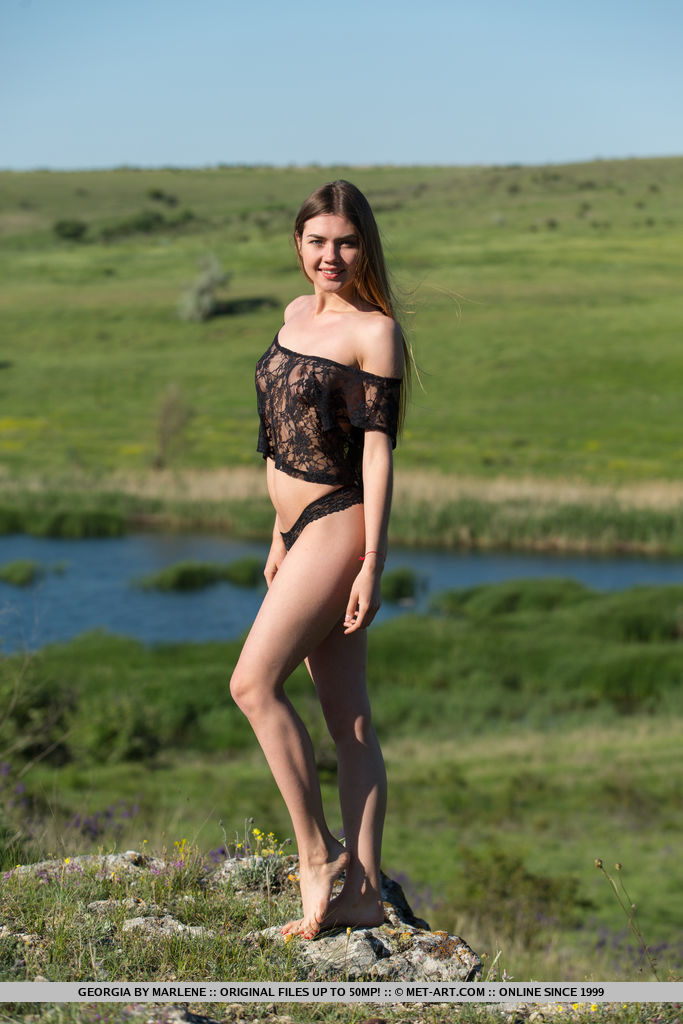 Top model Georgia strips on the grassy field baring her sexy body.