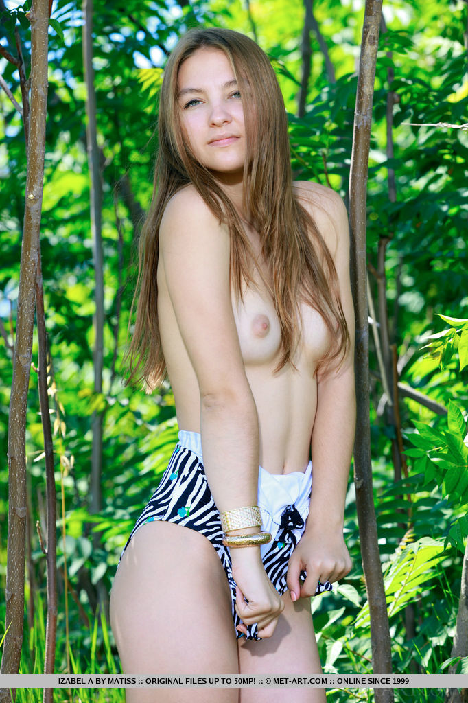 Wearing a zebra printed one-piece bikini, Izabel A turns simple photo shoot in the woods into a daring striptease escapade that is daring and delightful.