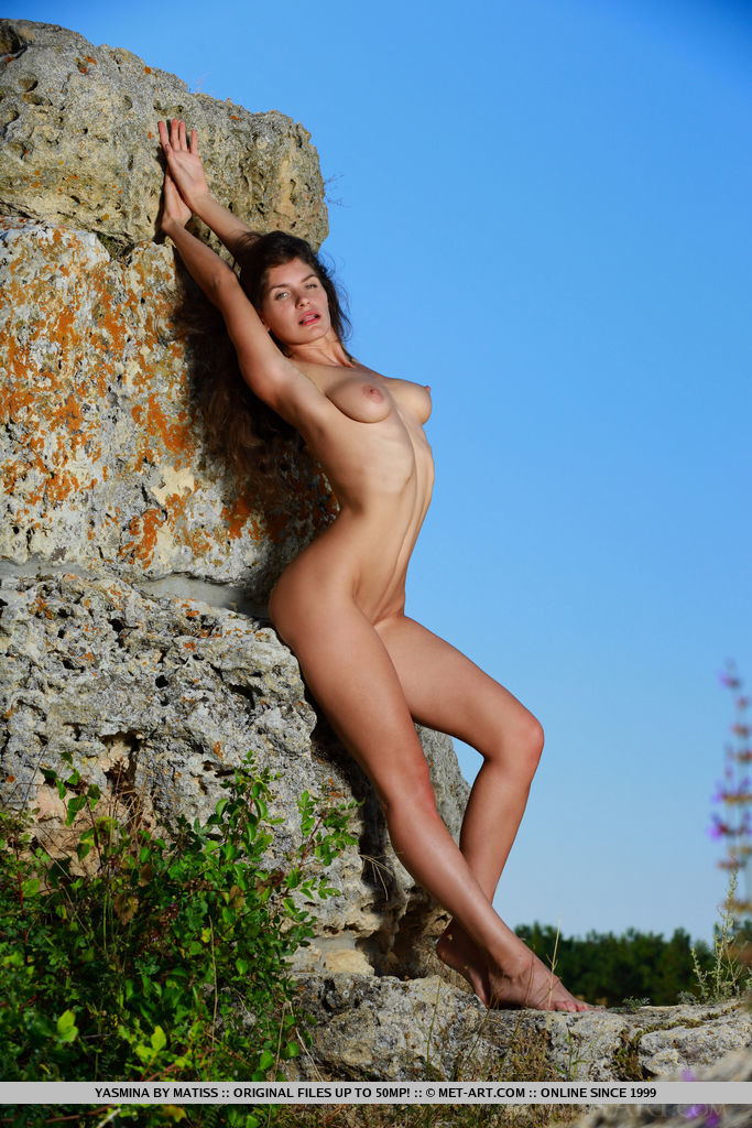 Yasmina strips outdoors baring her sexy, tight body.